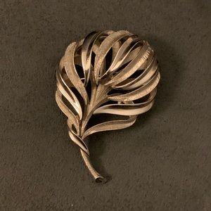 Silver tone Crown Trifari brooch.